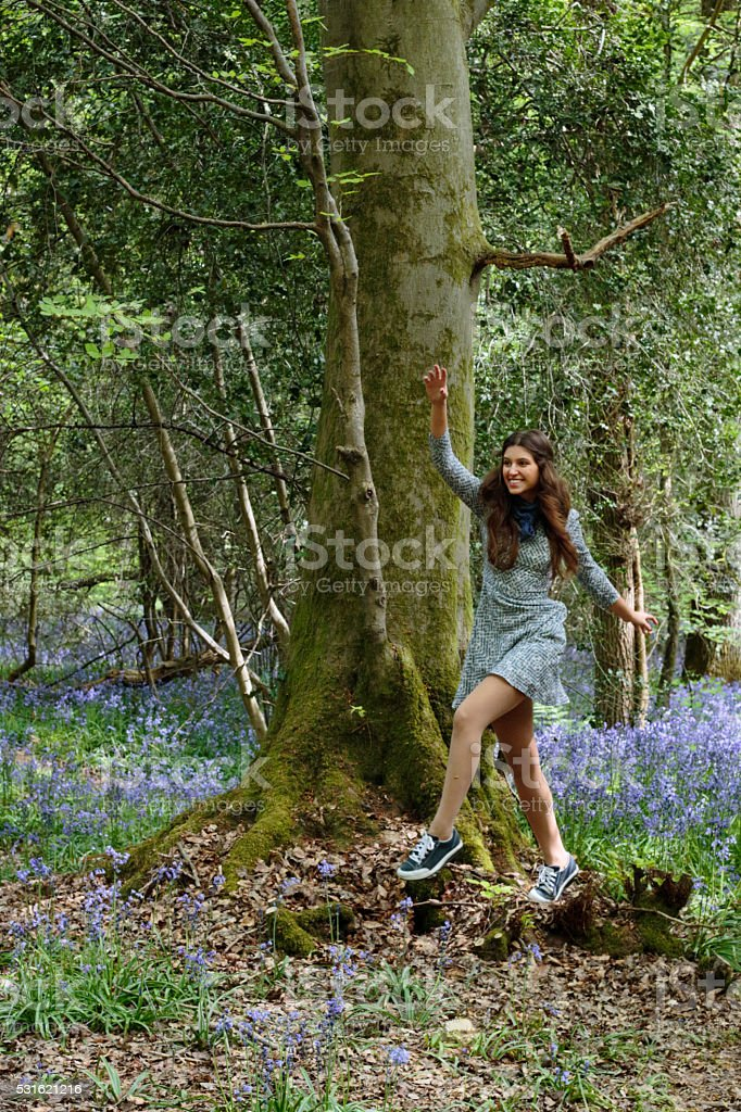 Dancing through the woods blue belle Russian outdoor girl stock photo