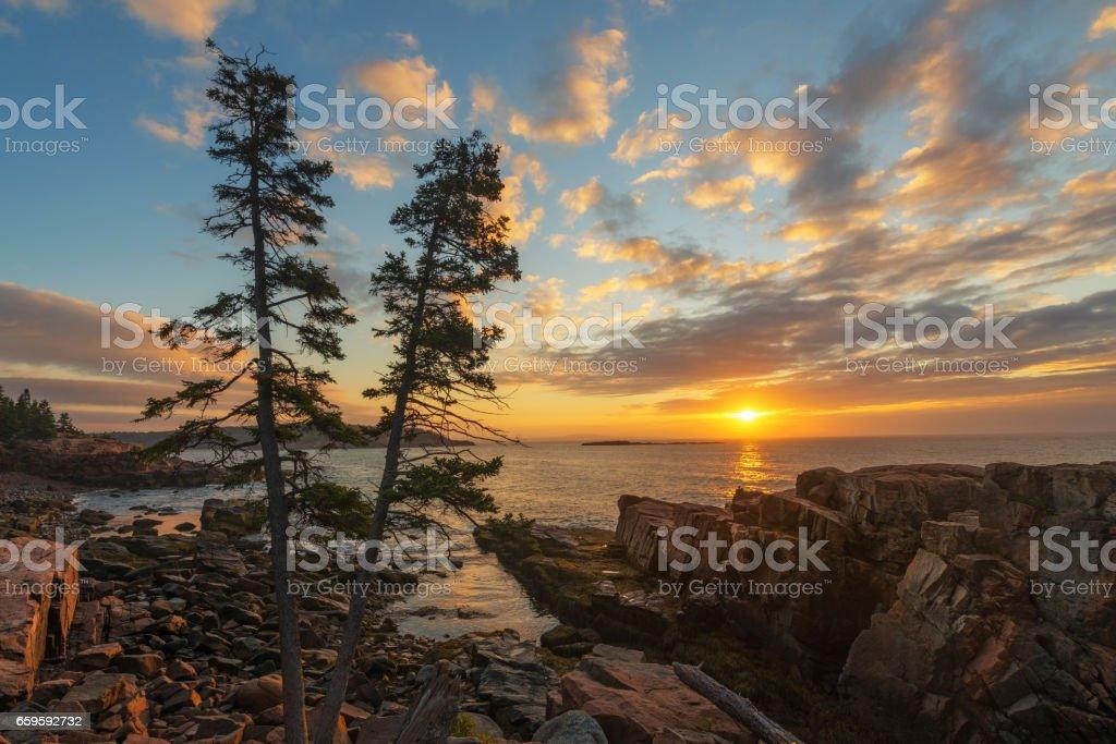 Beautiful sunrise along Maine's coastline stock photo