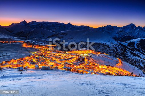 Stunning winter sunrise landscape and ski resort in French Alps,Alpe D Huez,France,Europe