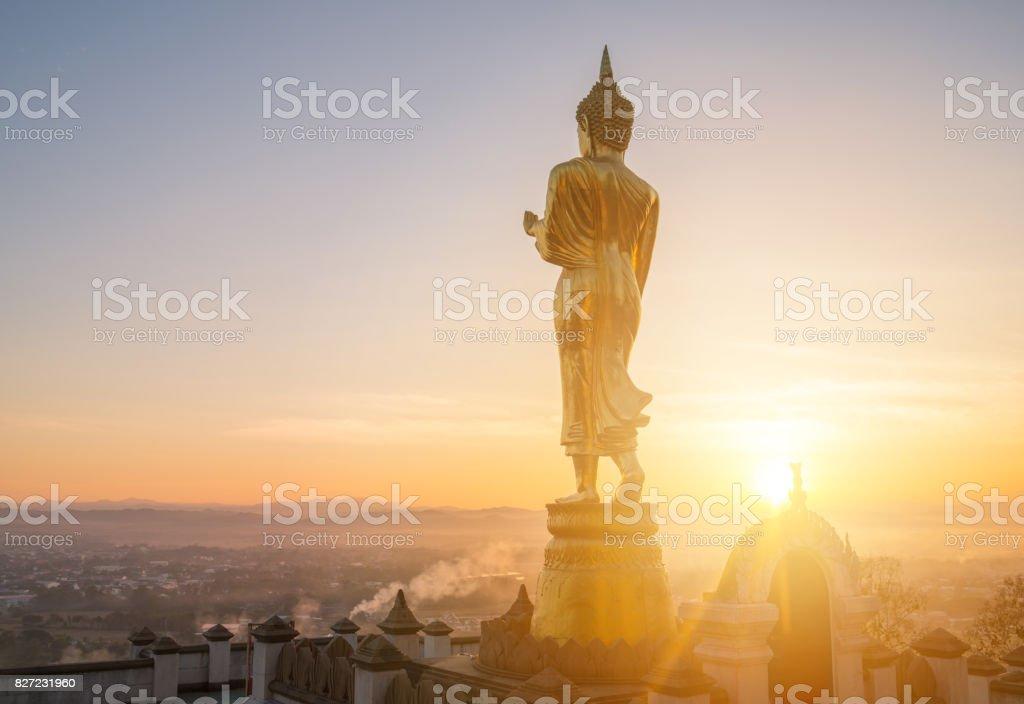 Beautiful sunrise and the iconic Buddha statue of Nan province, Thailand. stock photo