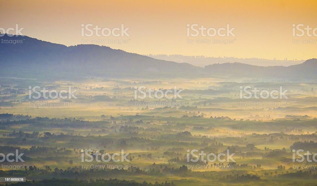 Beautiful sunrise at misty morning mountains . royalty-free stock photo