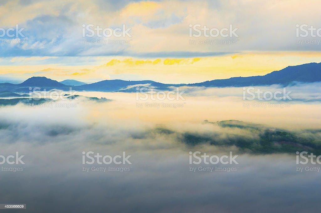 Beautiful sunrise at misty morning mountains . royalty-free stock photo