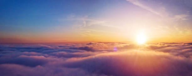 beautiful sunrise cloudy sky from aerial view - восход солнца стоковые фото и изображения