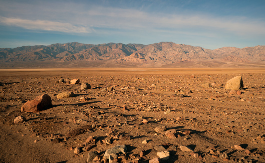 The sun rises to light the dry basin in Death Valley