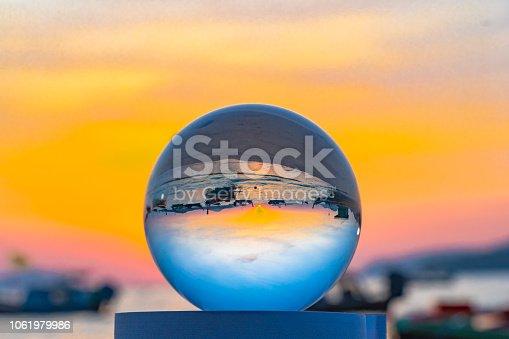 istock beautiful sunrise in clear quartz crystal ball 1061979986