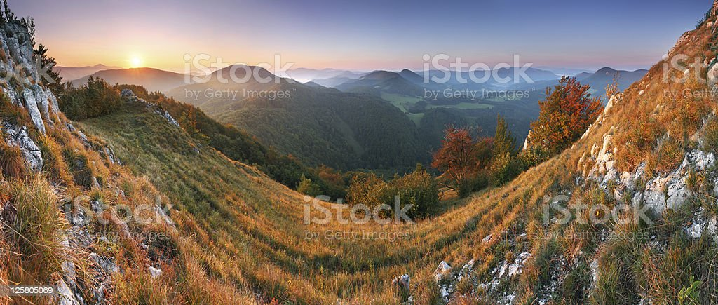 Beautiful sunrise in mountain valley with sun royalty-free stock photo