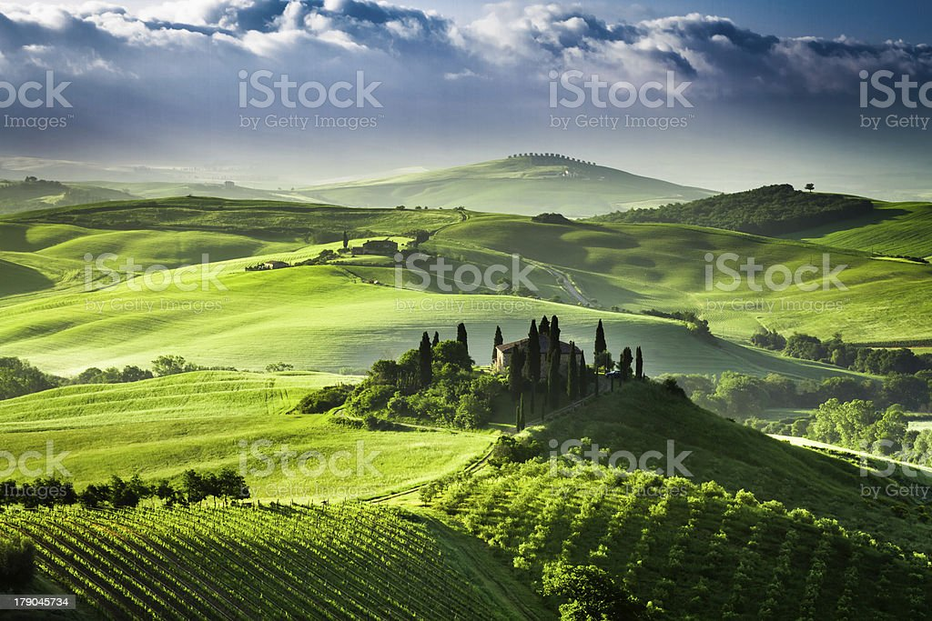Beautiful sunrise in the valley of San Quirico d'Orcia, Tuscany, stock photo