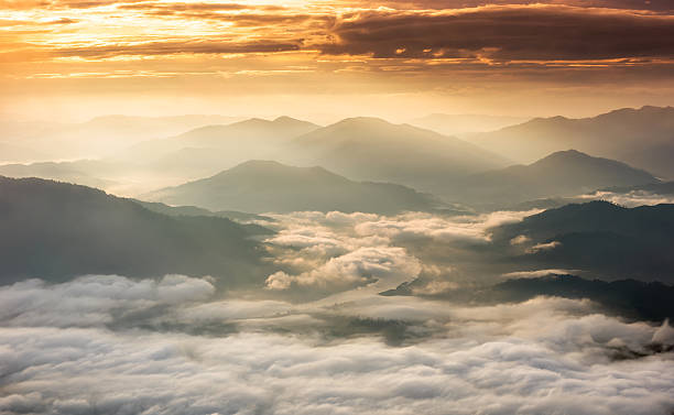 Beautiful Sunrise of travel place with morning mist Beautiful Sunrise of travel place with morning mist at Phu chi dao in Chiangrai,Thailand taoism stock pictures, royalty-free photos & images