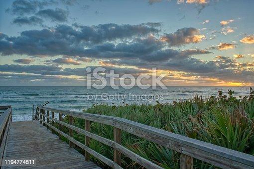 istock Beautiful Sunrise on the Beach Over the Atlantic Ocean on Merritt Island National Wildlife Refuge Florida 1194774811