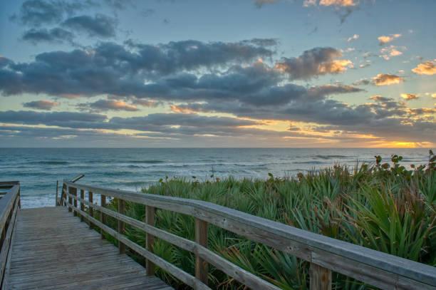 Beautiful Sunrise on the Beach Over the Atlantic Ocean on Merritt Island National Wildlife Refuge Florida stock photo