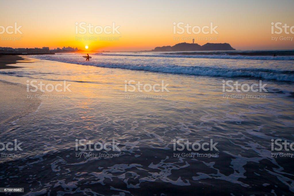 Beautiful sunrise on the beach with Enoshima stock photo