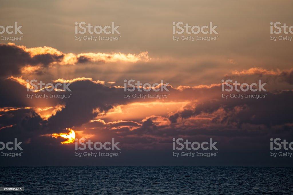 Beautiful sunrise over an ocean horizon. Dawn at sea. stock photo