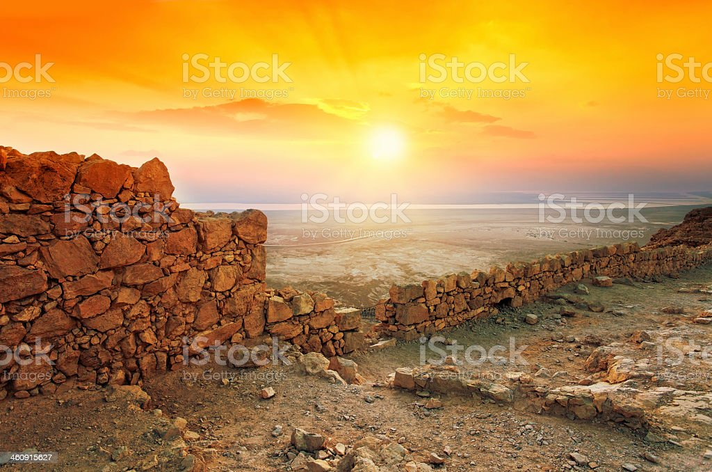 Beautiful sunrise over Masada fortress in Judaean Desert stock photo