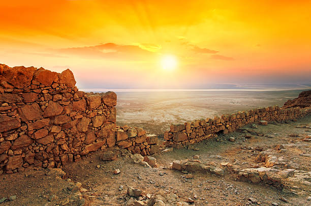 Beautiful sunrise over Masada fortress in Judaean Desert Beautiful sunrise over Masada fortress in Judaean Desert historical palestine stock pictures, royalty-free photos & images