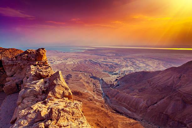 beautiful sunrise over masada fortress - israël stockfoto's en -beelden