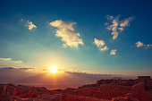 Beautiful sunrise over the Dead Sea. View from Masada fortress. Ruins of King Herod's palace in Judaean Desert