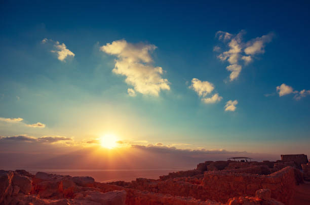 Beautiful sunrise over the Dead Sea. View from Masada fortress. Ruins of King Herod's palace in Judaean Desert Beautiful sunrise over the Dead Sea. View from Masada fortress. Ruins of King Herod's palace in Judaean Desert sunrise stock pictures, royalty-free photos & images