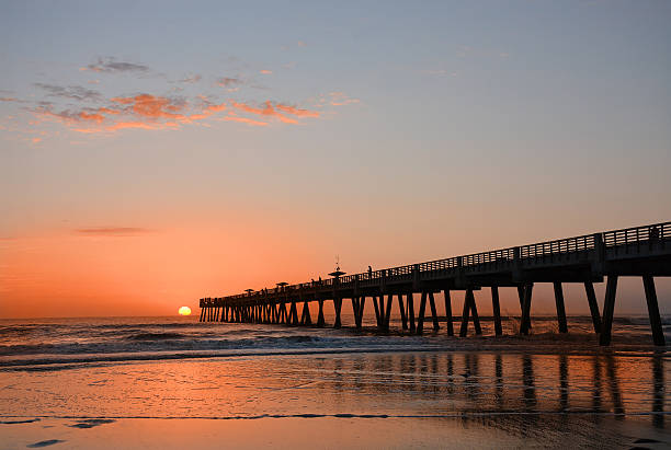 Beautiful sunrise over the ocean and pier. stock photo