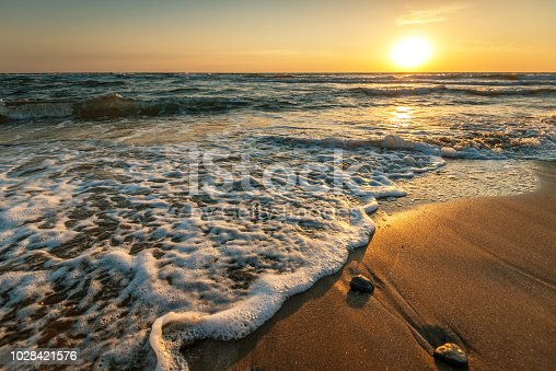 istock Beautiful sunrise over the sea. 1028421576
