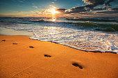 Woman walking on the beach in Hawaii.