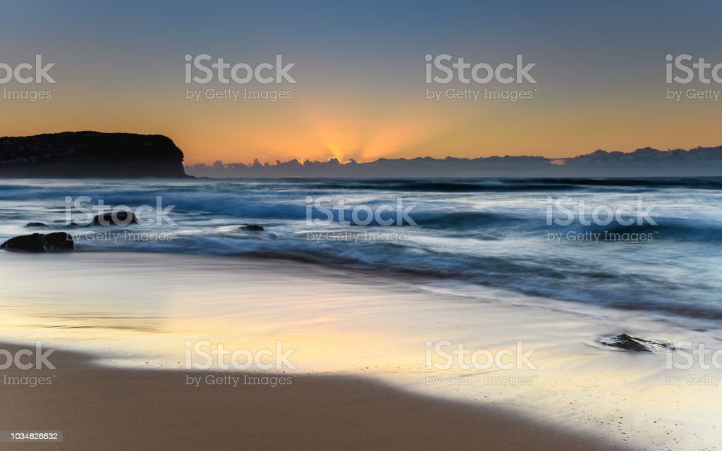 Beautiful Sunrise Seascape with Low Cloud Bank stock photo