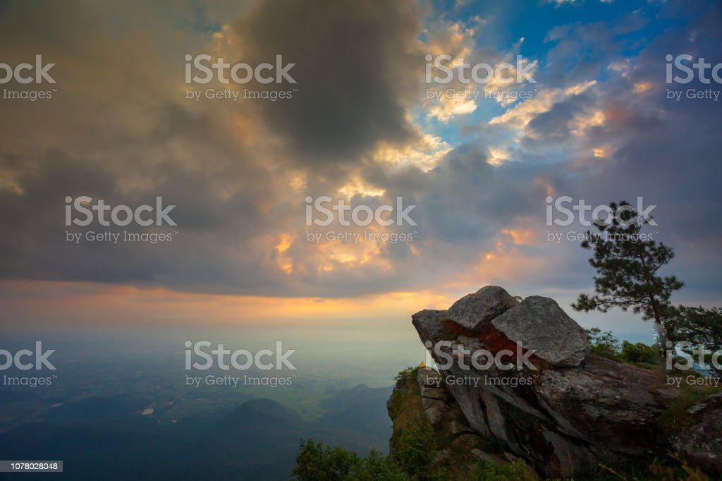 Beautiful Sunrise Sky with Rocky cliff in the morning on Khao Luang mountain in Ramkhamhaeng National Park stock photo