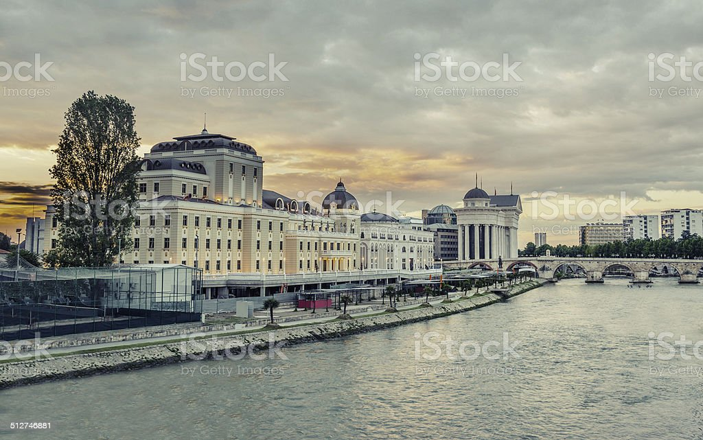 beautiful sunrise, stone bridge and Vardar river in Skopje, VINTAGE stock photo