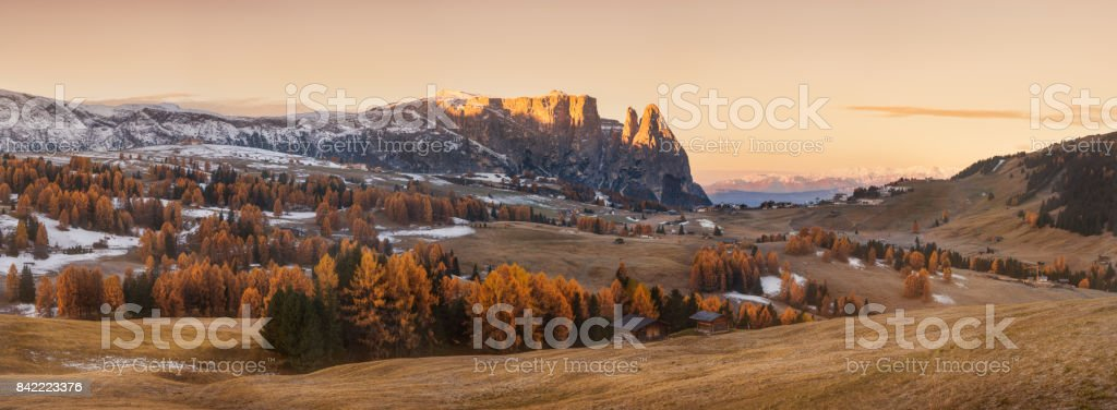 Beautiful sunrise view of meadow Seiser Alm (Alpe di Siusi) with Odle - Geisler mountain group on background. Morning autumn scenery in Dolomite Alps, South Tyrol, Italy. stock photo