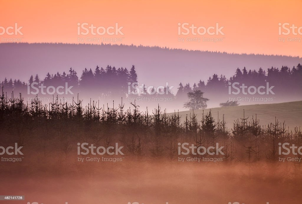 Beautiful sunrise with mist and hills near Winterberg, Sauerland, Germany stock photo
