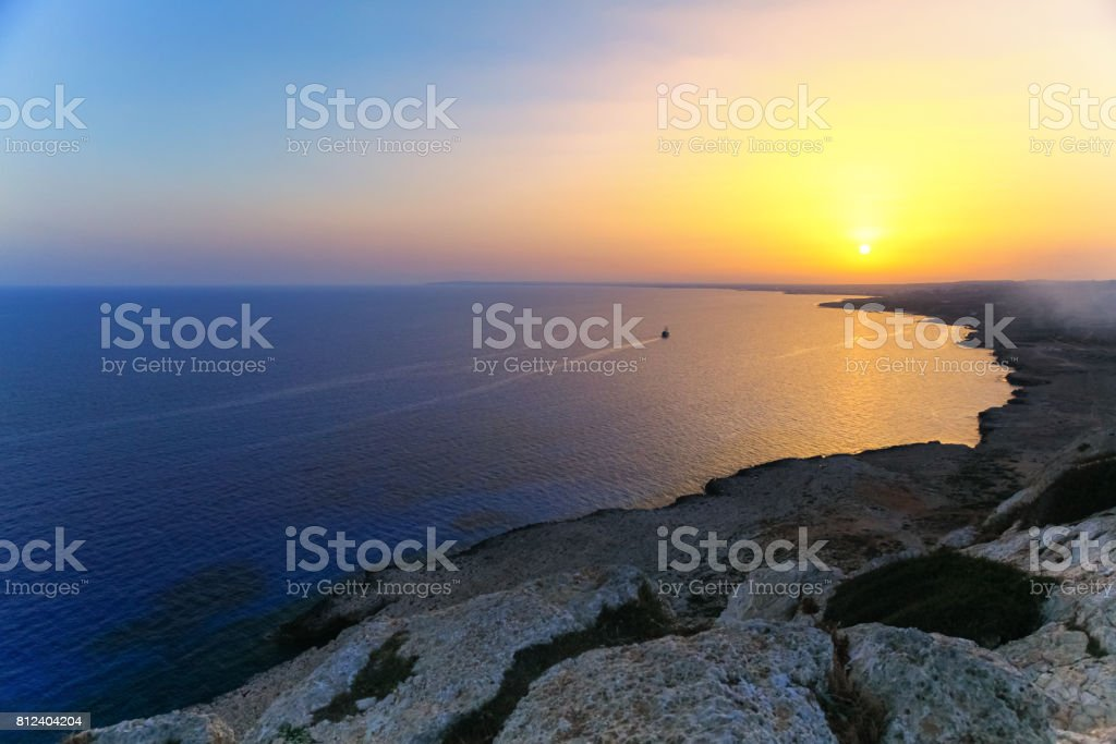 Beautiful sunrise with ship on the sea on Aya Napa, Cyprus stock photo