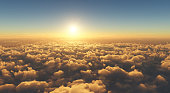 high angle view of beautiful golden sunset above clouds