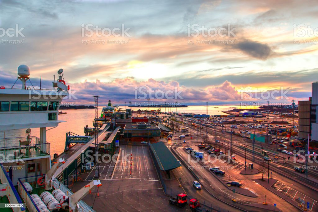 Beautiful sunset and port area depicting busy modern industrial port, transportation, international commerce, Helsinki, Finland. stock photo