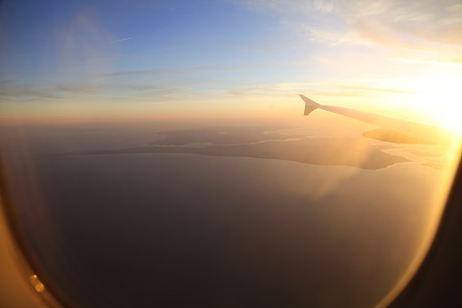beautiful sunset and sky was taken from window seat on the airplane fly around the world