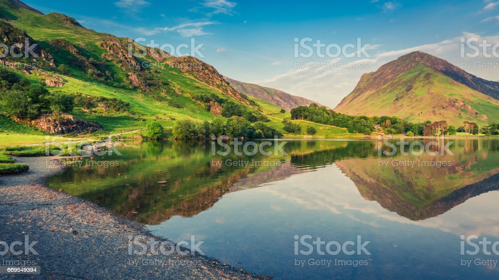 Beautiful sunset at lake in District Lake in England stock photo