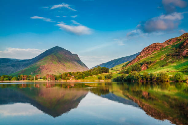 beautiful sunset at lake in district lake, uk - cumbria stock photos and pictures