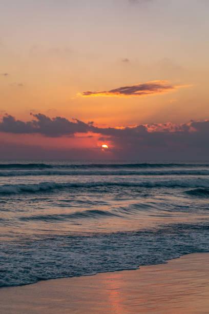 Beautiful sunset at Seminyak beach on Bali island stock photo