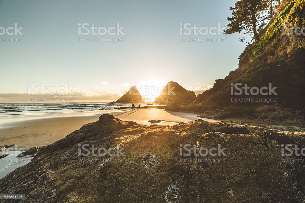 Beautiful sunset between two sea rock stacks stock photo