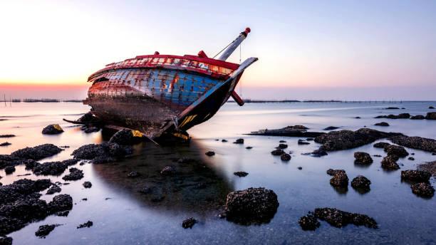 beautiful sunset  ,boat crashes in the sea , landscape  Thailand stock photo