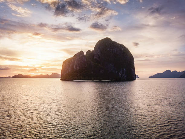 Beautiful Sunset El Nido Palawan Philippines Beautiful Sunset at Pinagbuyutan Island Aerial Drone Point of View, El Nido, Palawan Island, Philippines, Asia pinagbuyutan island stock pictures, royalty-free photos & images