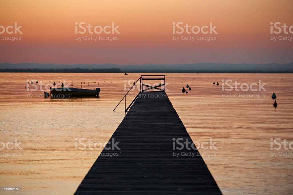 beautiful sunset from the pier on Lake Garda royalty-free stock photo