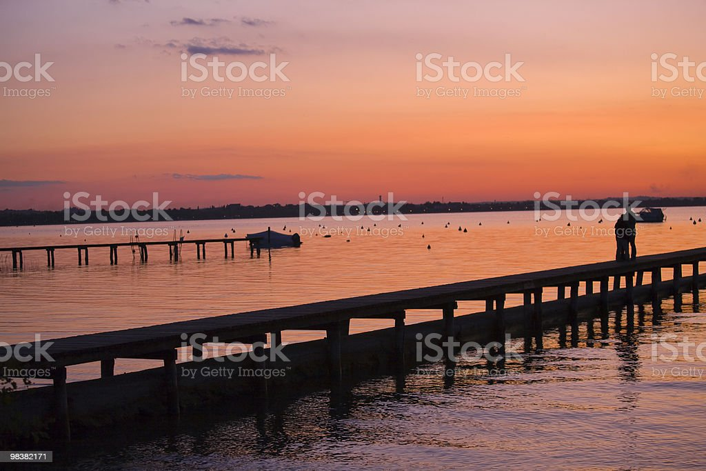 beautiful sunset from the pier on Lake Garda royalty-free stock photo