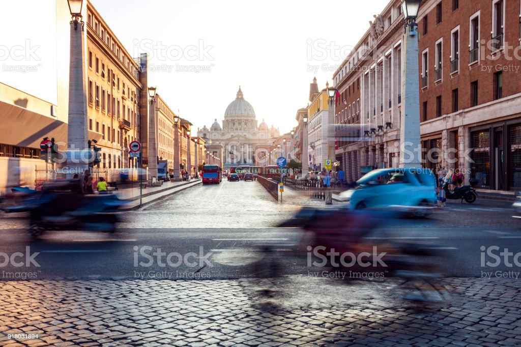 Beautiful sunset in Rome on old cobblestone streets stock photo
