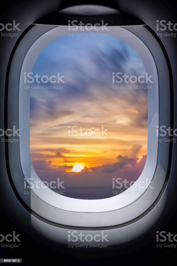 Beautiful sunset in seascape from aircraft window Beautiful sunset in seascape from aircraft window stock photo
