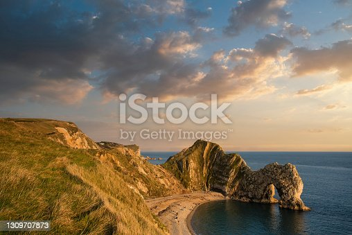 istock Beautiful sunset landscape image of Durdle Door 1309707873