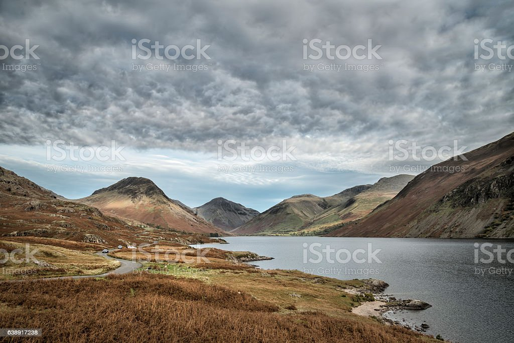Beautiful sunset landscape image of Wast Water and mountains in stock photo