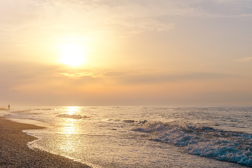 Beautiful sunset nature in the dark evening, sunset sunrise scene, very attractive and blurry sky with attractive and colorful nature over the dark shine ripples of sea ocean. Natural background