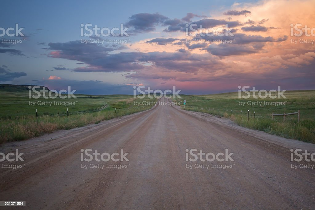 Beautiful sunset on a gravel dirt road stock photo