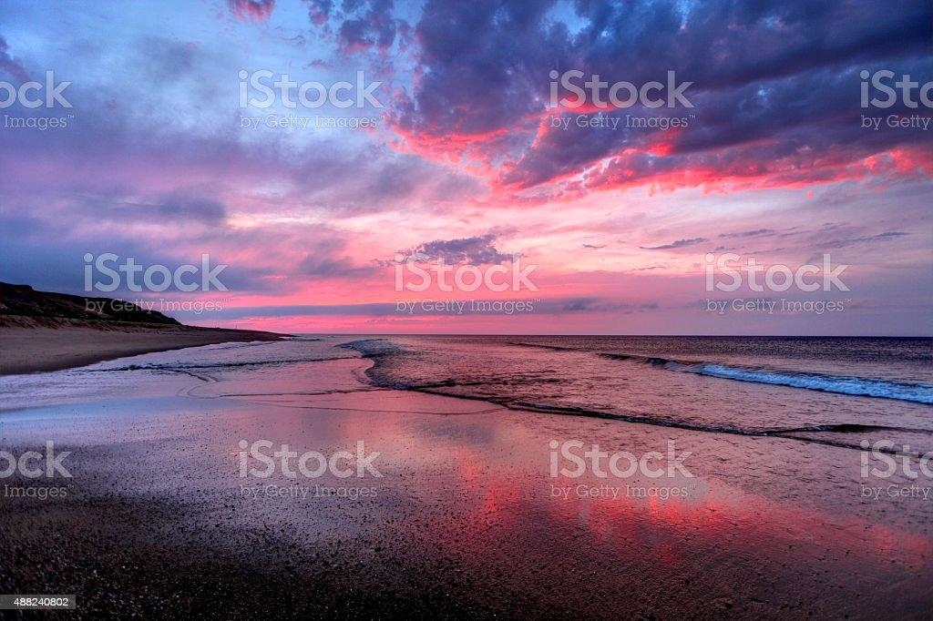 Beautiful sunset on a long empty beach on Cape Cod stock photo