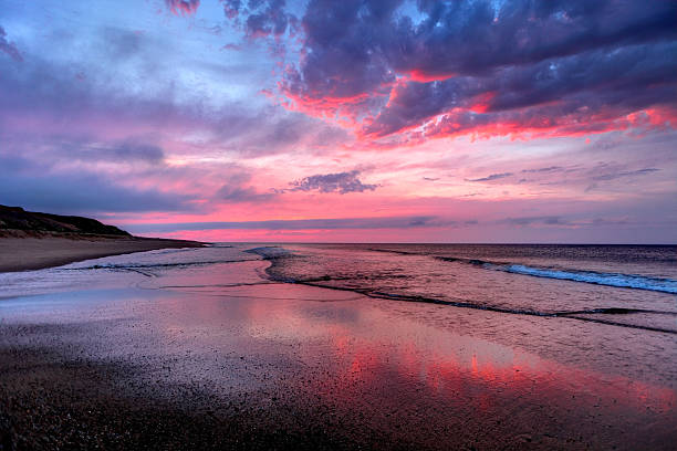 Beautiful sunset on a long empty beach on Cape Cod Beautiful sunset a long empty beach on Cape Cod. Cape Cod is famous, worldwide, as a coastal vacation destination with some of New England's premier beach destinations provincetown stock pictures, royalty-free photos & images