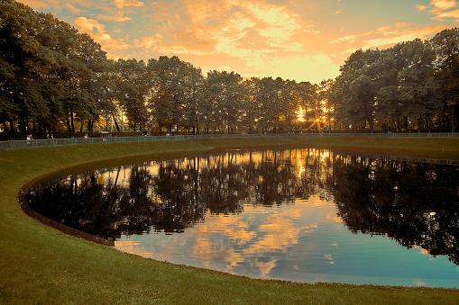 Beautiful sunset on Karpeev pond lake in the Summer garden in Saint Petersburg Russia.